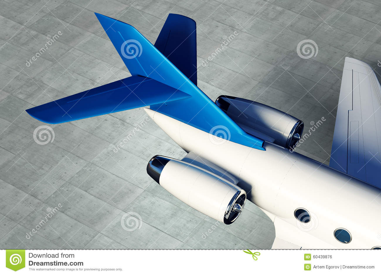 Motor a reacción privado de los aviones con una pieza de un ala en fondo concreto del piso
