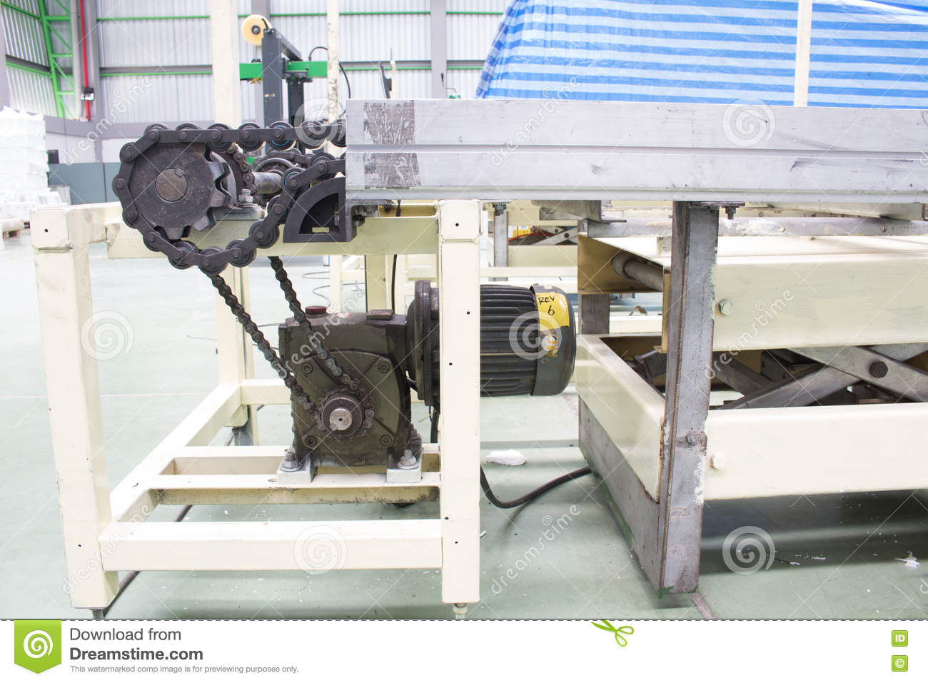 Motor Shaft And Gear Drive Chain Of Conveyor Line Stock