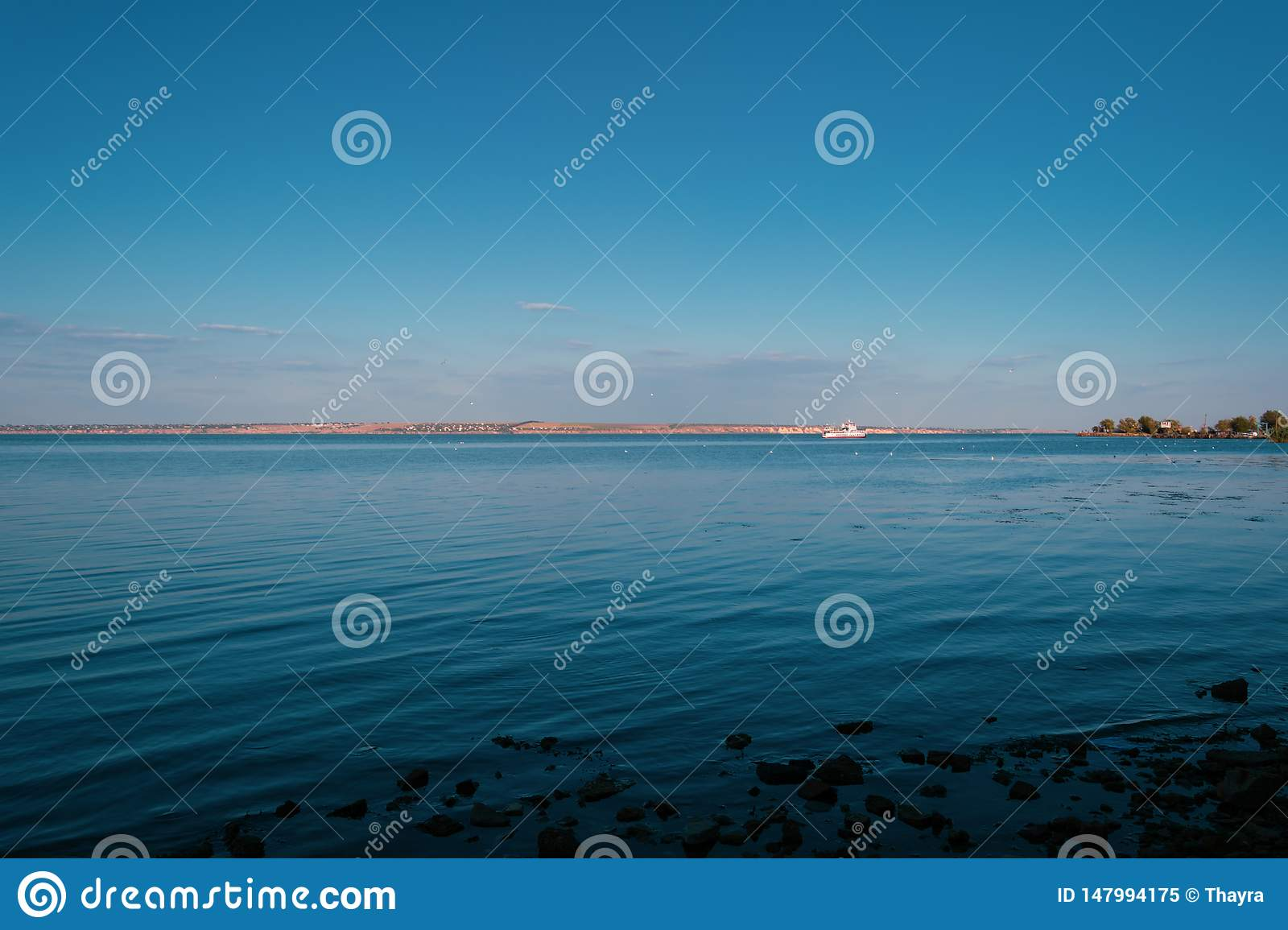 Motor ship in the sea in the evening sunlight over sky background. Summer adventure or vacation concept. Copy space