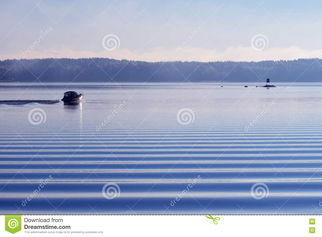 Motorboat on calm cold sea