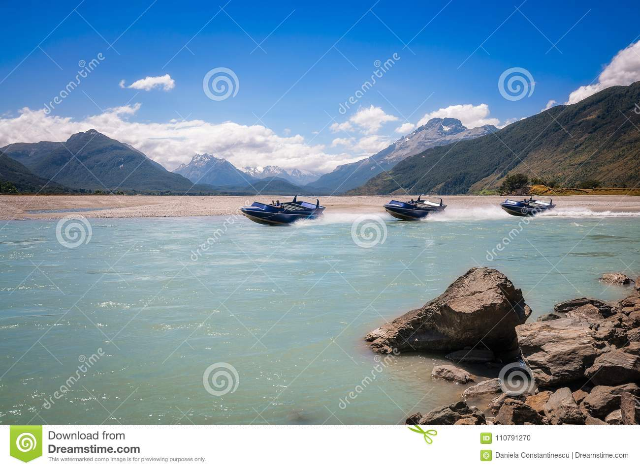 A motorboat on Dart River at Isengard lookout in New Zealand