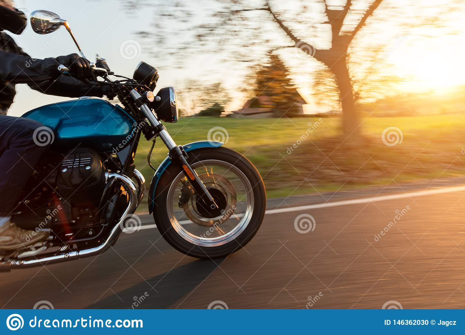 Motorcycle driver riding in European road