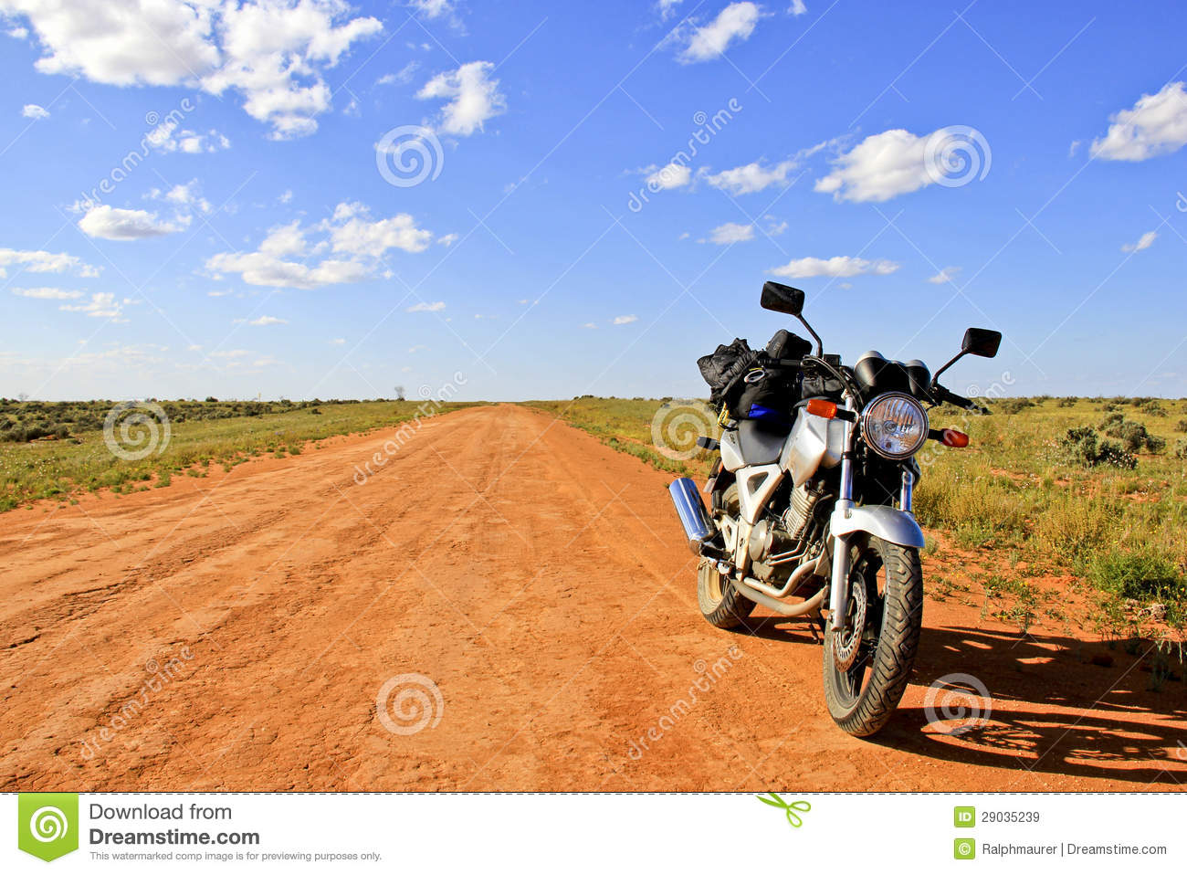 motorcycle on an empty dirt road outback australia royalty