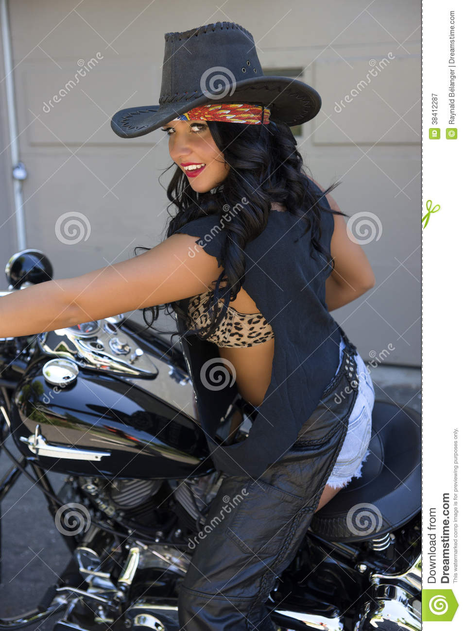 picture of beautiful young woman with harley davidson motorcycle