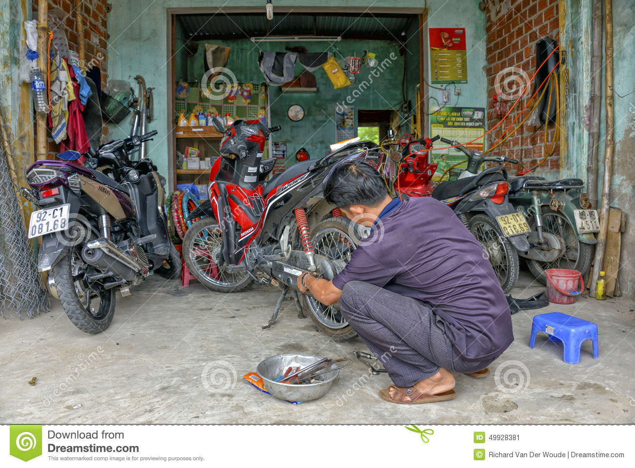 motorcycle mechanic repairing flat tire scooter editorial