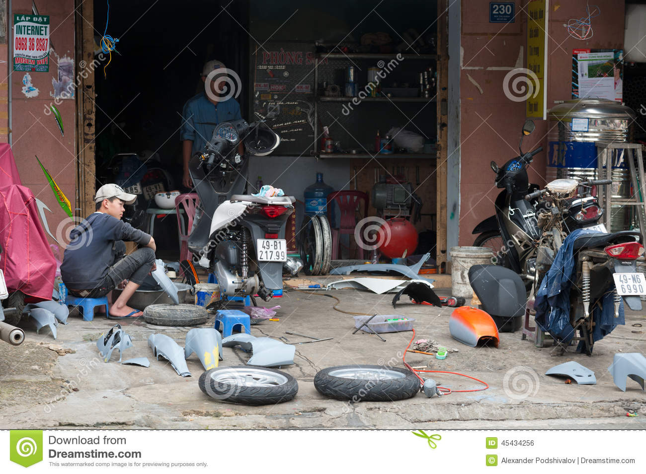 Motorcycle repair shop vietnam editorial photo image for Motorized bicycle repair shop