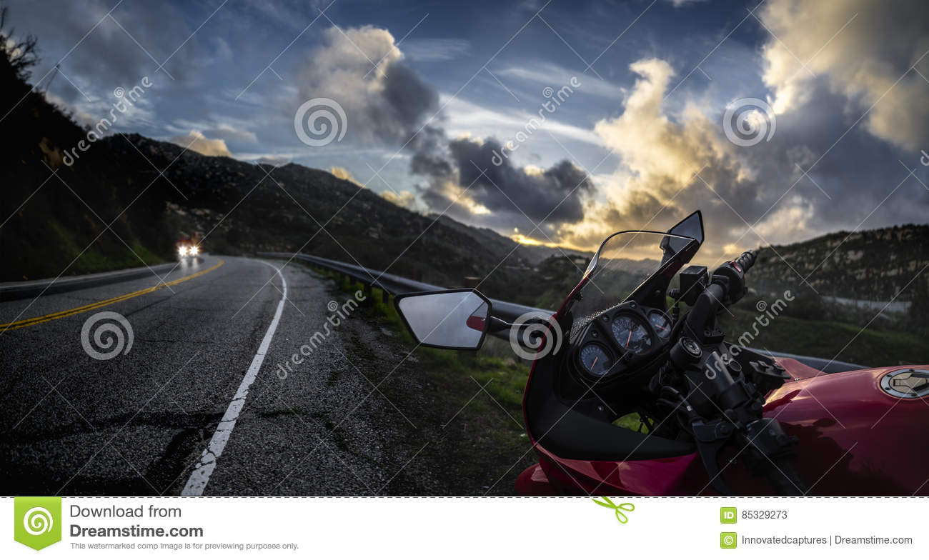 Motorcycle on a Road at Sunset