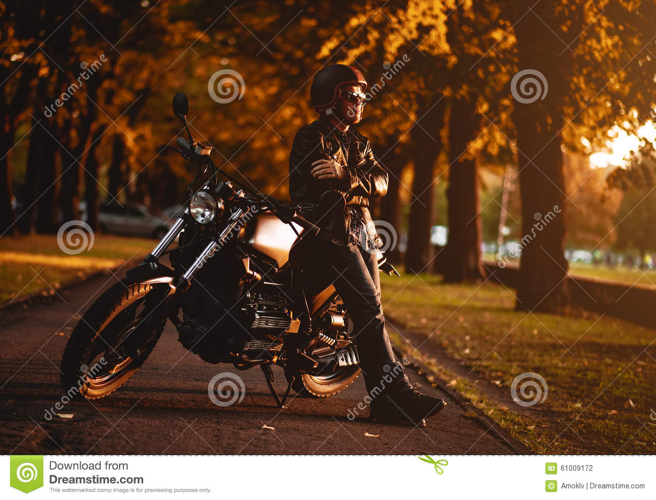 Motorcyclist with a cafe-racer motorcycle