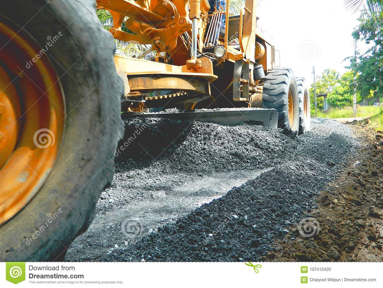 Motorgrader Are Adjusted To Smooth The Crushed Rock For Road