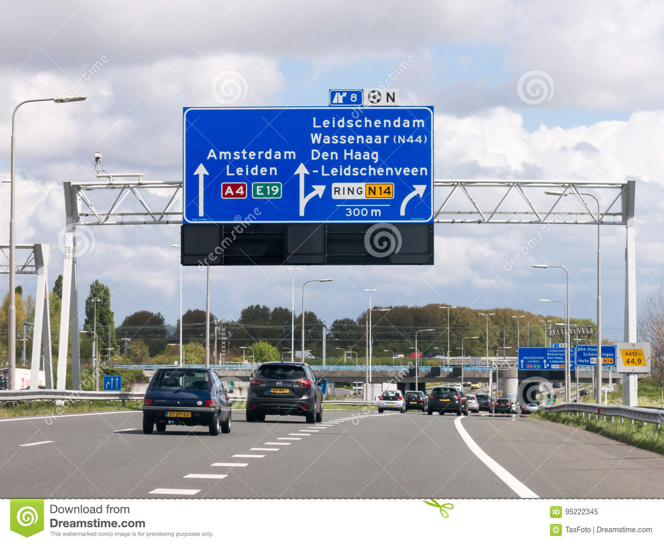 Motorway A4 with traffic and route signs, The Hague, Netherlands
