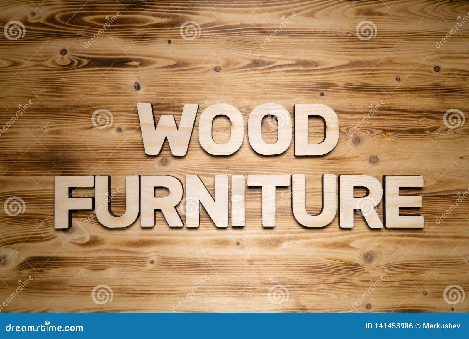 Mots EN BOIS de MEUBLES faits de lettres en bois sur le conseil en bois