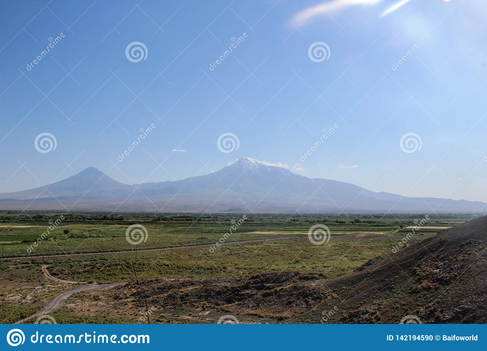 Mount Ararat from distance with green fields