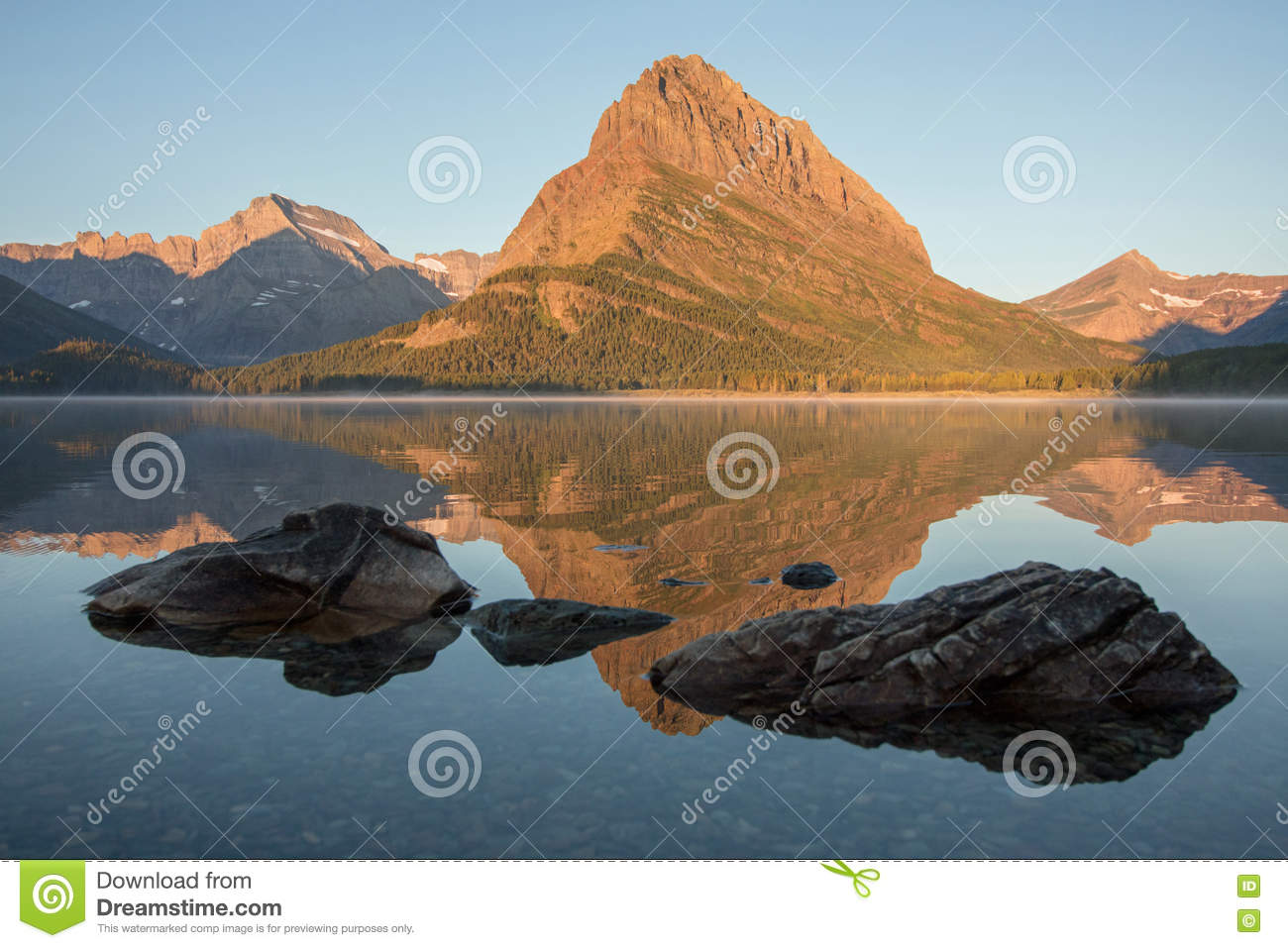 mount grinnell reflected in swiftcurrent lake stock photo image of
