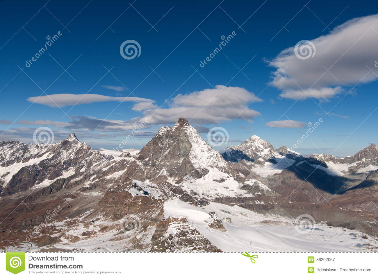 Mount Matterhorn covered with clouds on a clear day after snow fall in autumn, Valais