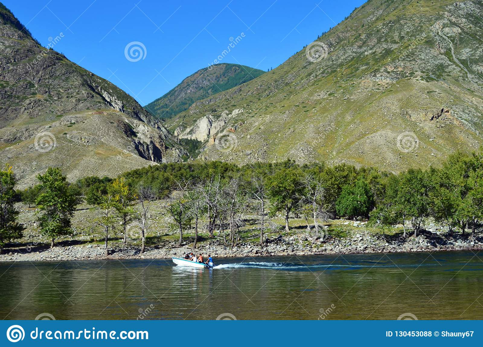 Mountain Altai. Crossing the Chulyshman river by motor boat