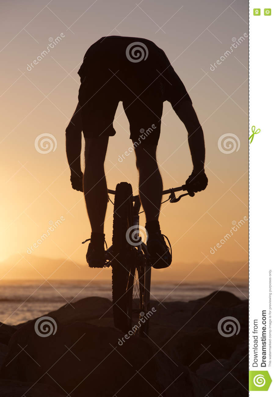 Mountain bike rider and sunset South Africa