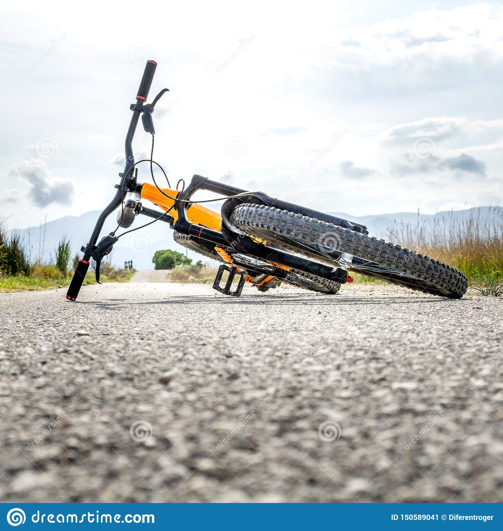 Mountain bike stretched on the ground without people