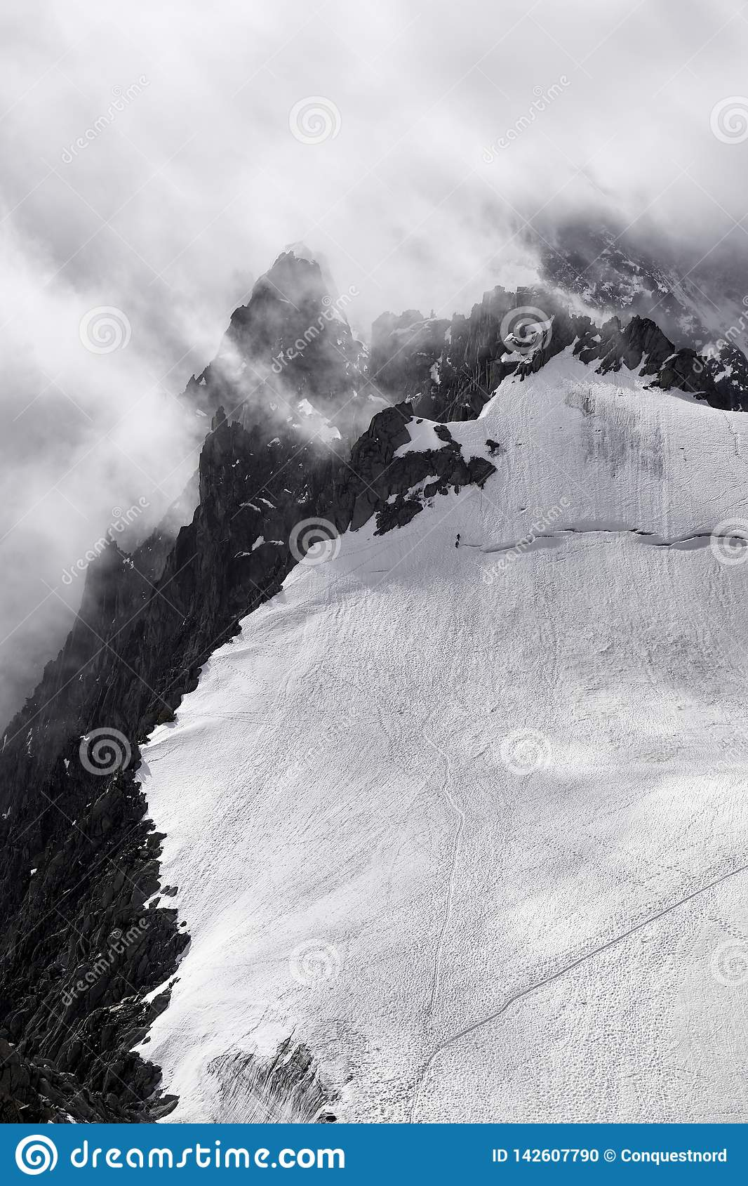 Mountain in Chamonix  in a bad weather with climbers