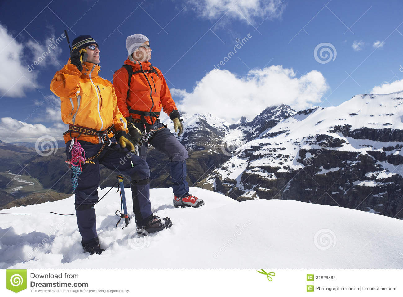 Mountain Climber Using Walkie Talkie By Friend On Snowy ...