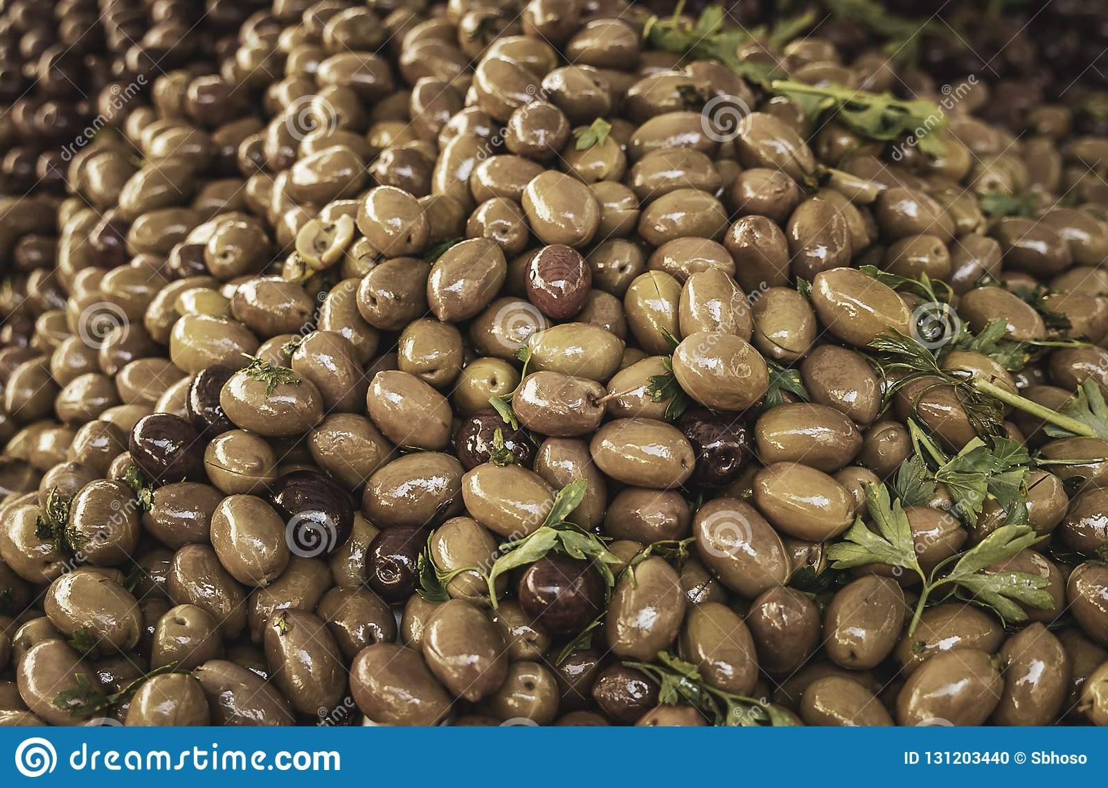 Fresh delicious green and black olives from a local farmers market in Sicily