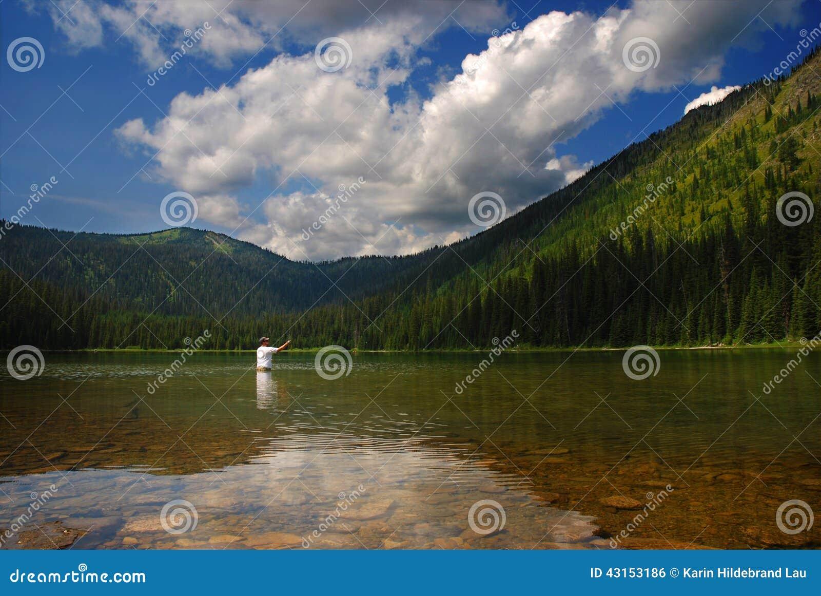 Mountain lake fisherman stock photo image 43153186 for Whitefish montana fishing