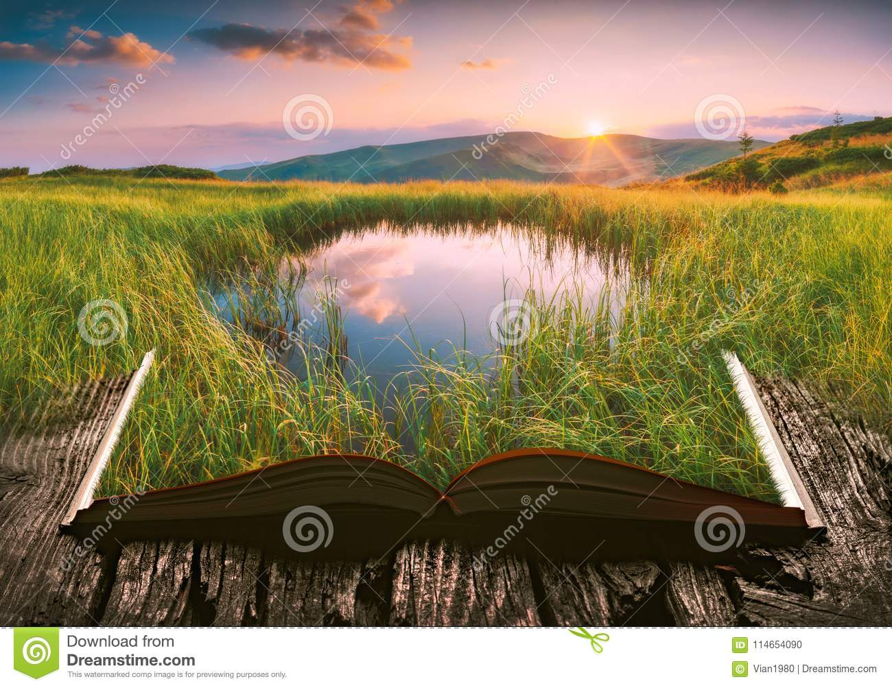 Mountain lake on the pages of an open book
