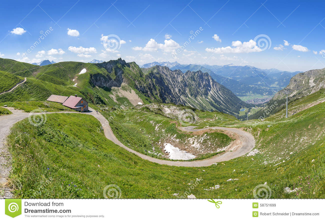 Mountain landscape with hiking trail and hut stock photo for Nearby landscapers