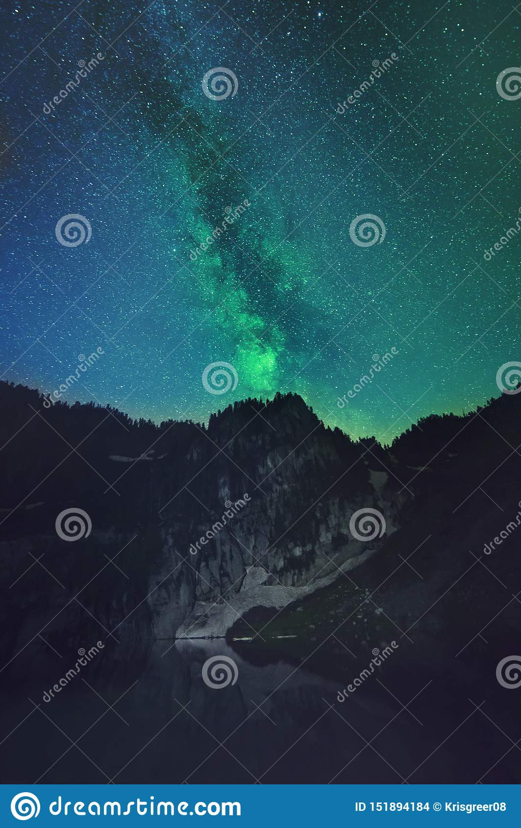 Mountain landscape with milky way visible behind it