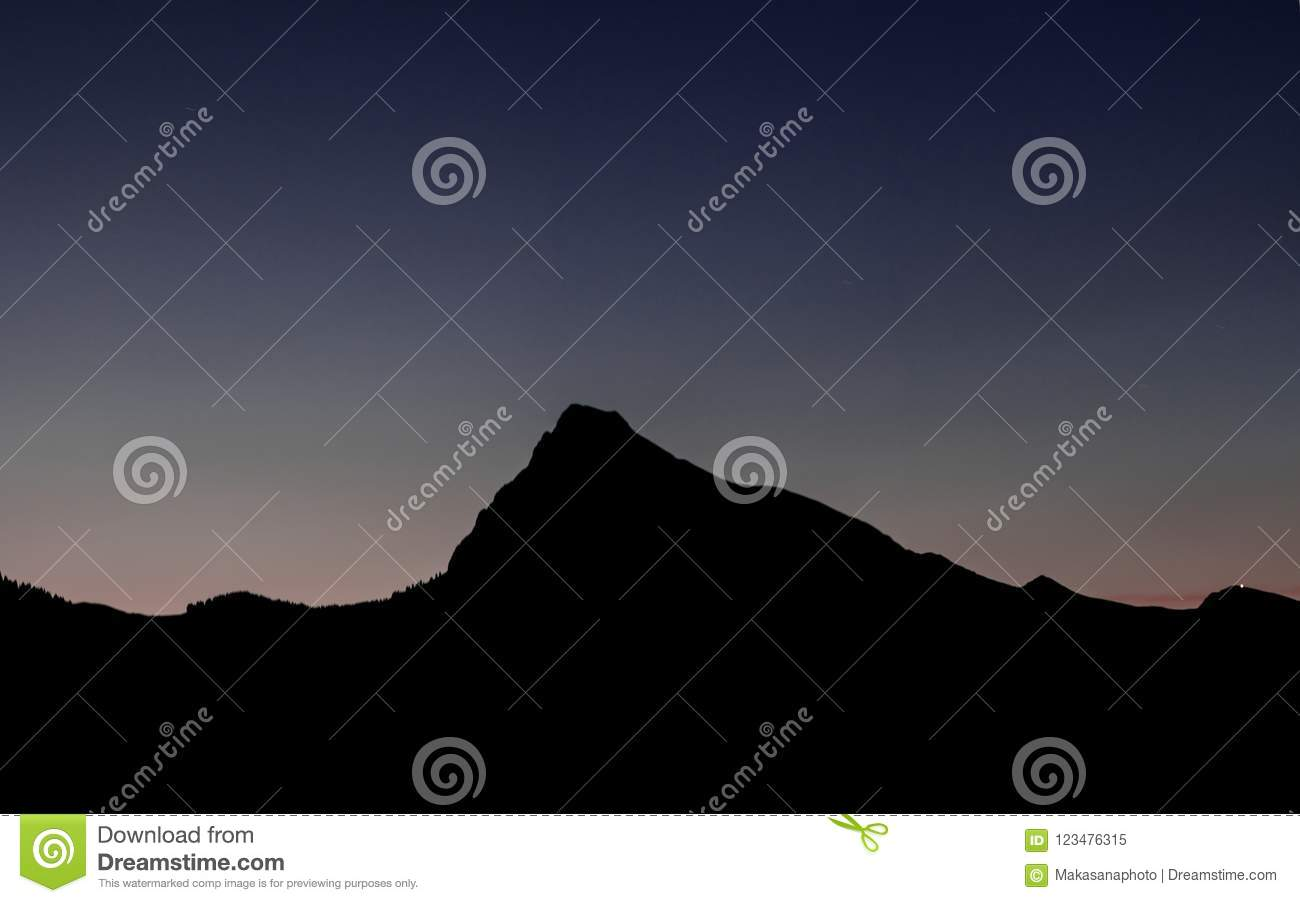 Mountain landscape silhouette under a late evening sky after sunset