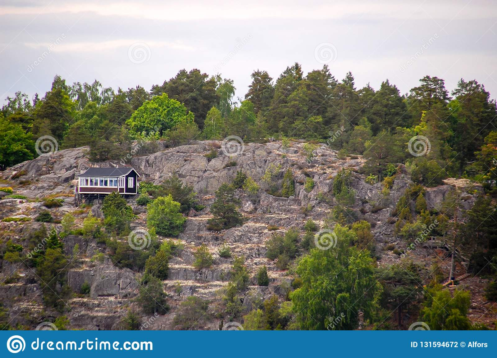 A Small House Built On The Cliffs Near The Sea Stock Photo Image