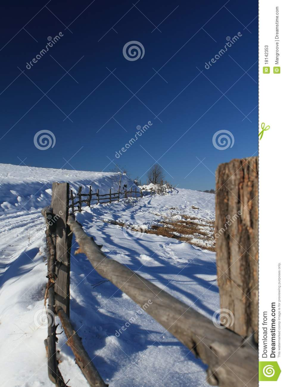 Mountain path and fence in winter