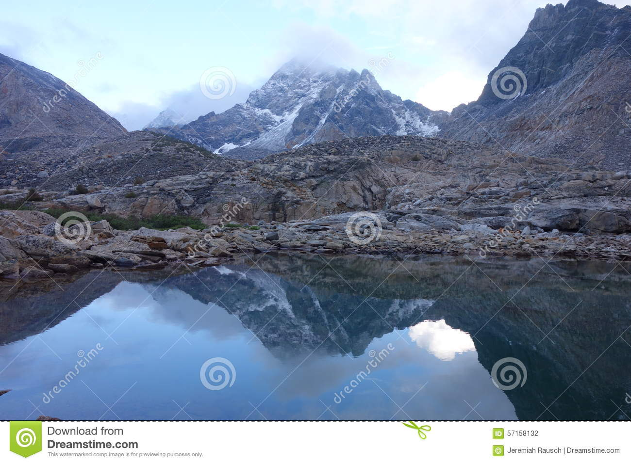 Mountain Reflection in Water with clouds