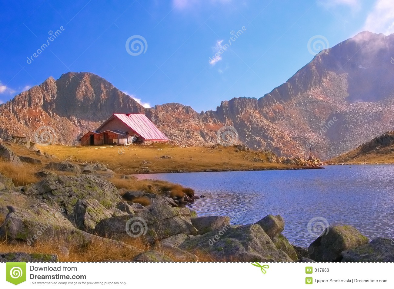 Mountain refuge next to a glacial lake in national park Pirin