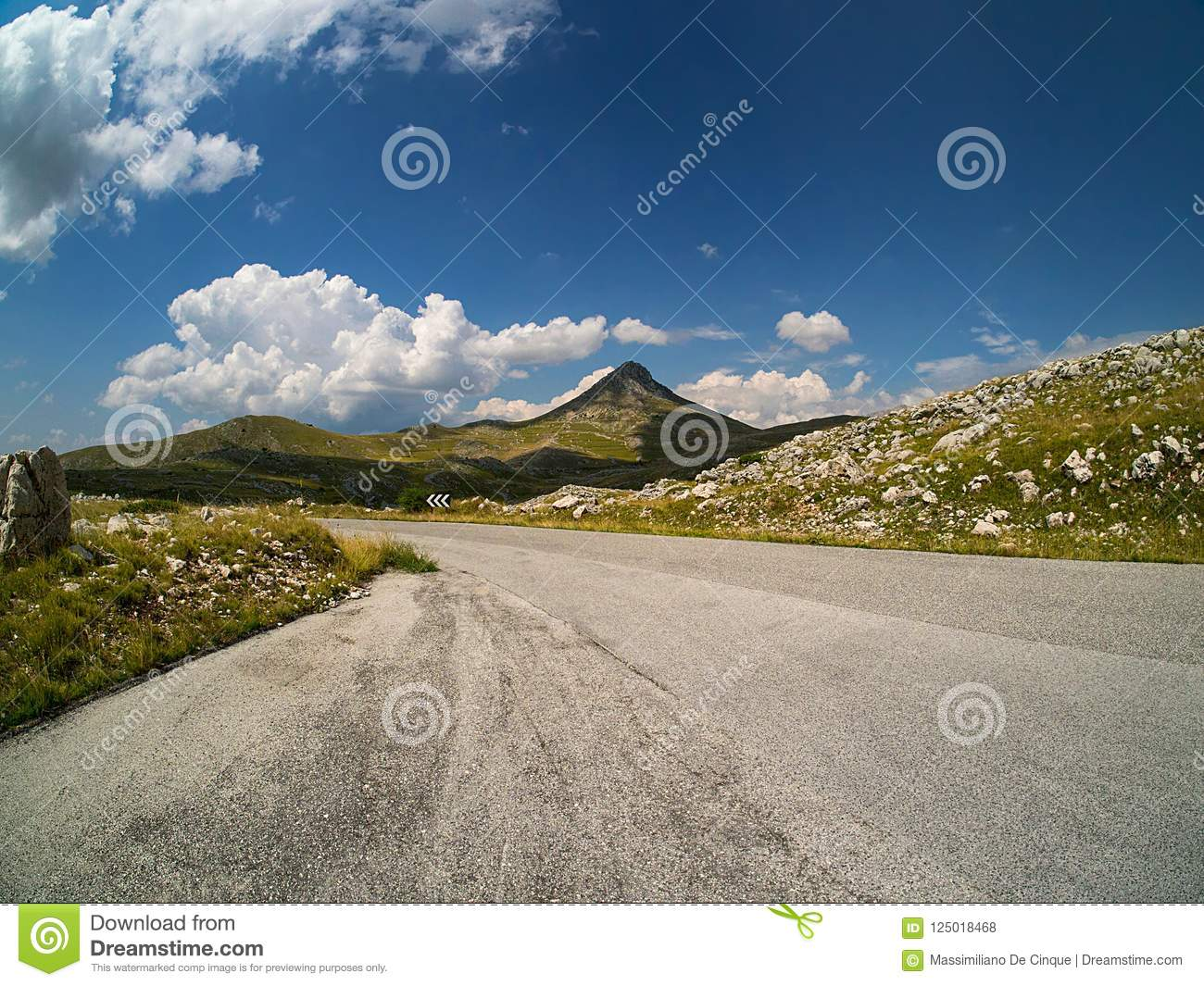 Mountain road with gentle pointy mountain