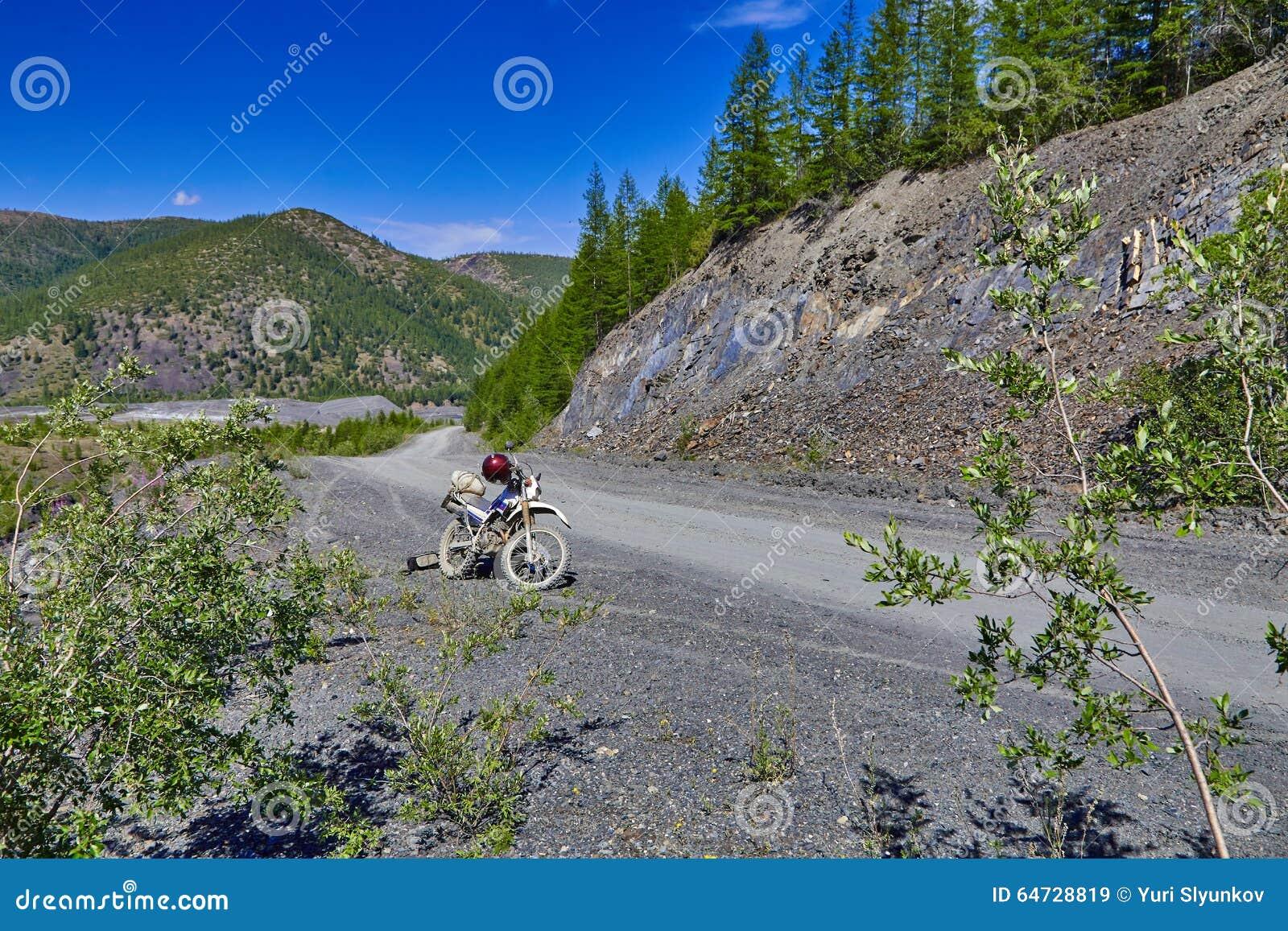 Mountain road. A motorcycle Enduro. Kolyma