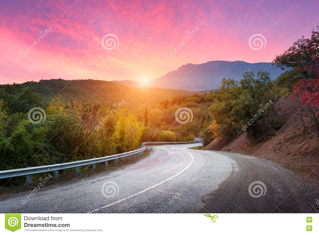 Download Mountain Road Passing Through The Forest With Dramatic Colorful Sky And Red Clouds At Colorful Sunset In Summer. Mountain Stock Photo - Image of journey, outdoor: 73321112
