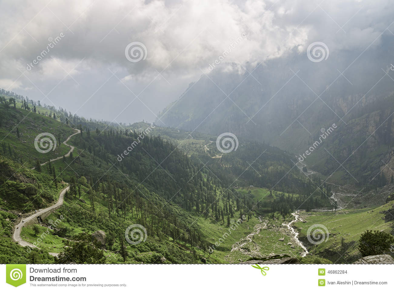 Mountain road among valley and river