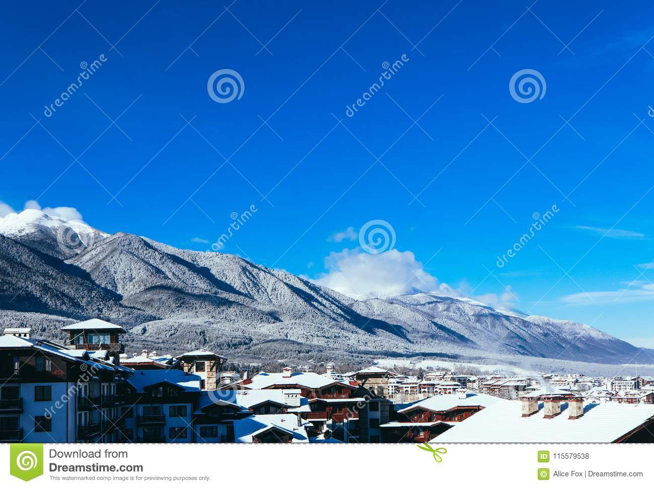 Mountain snow peak, Alpine village houses. Europe, old town winter ice hill top panoramic view.