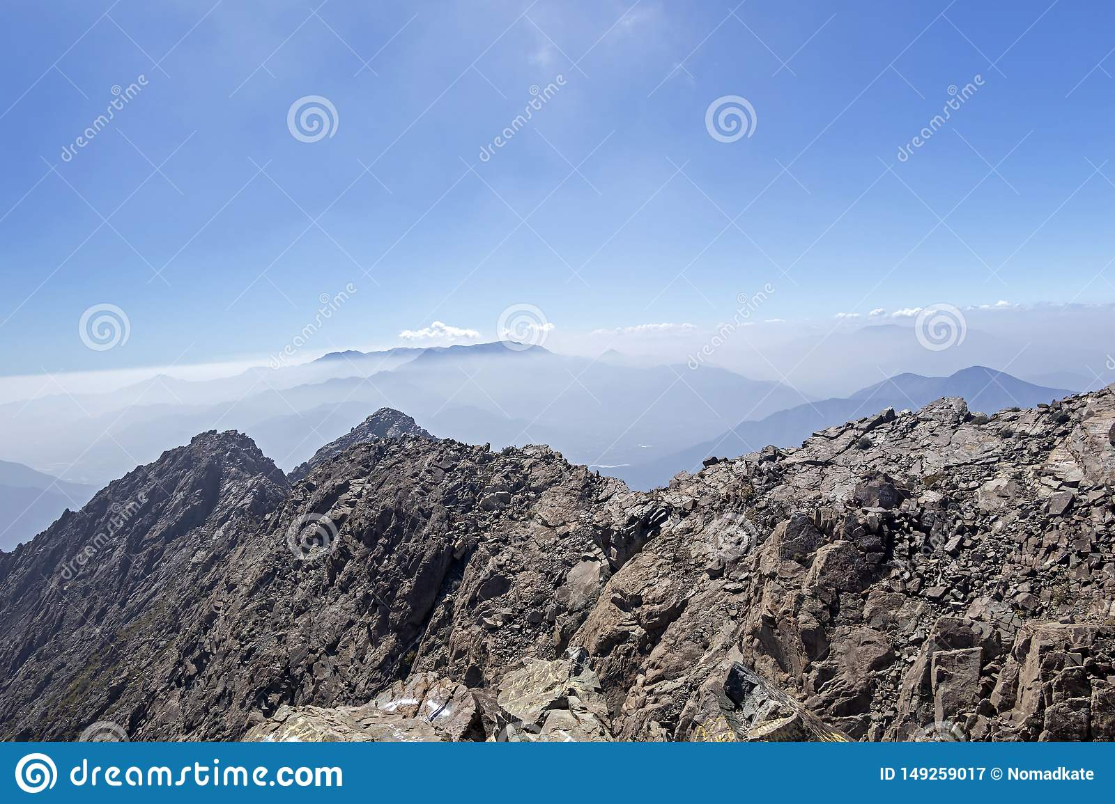 Mountain summit view with landscape of Andes and Aconcagua on clear day in La Campana National park in central Chile, South