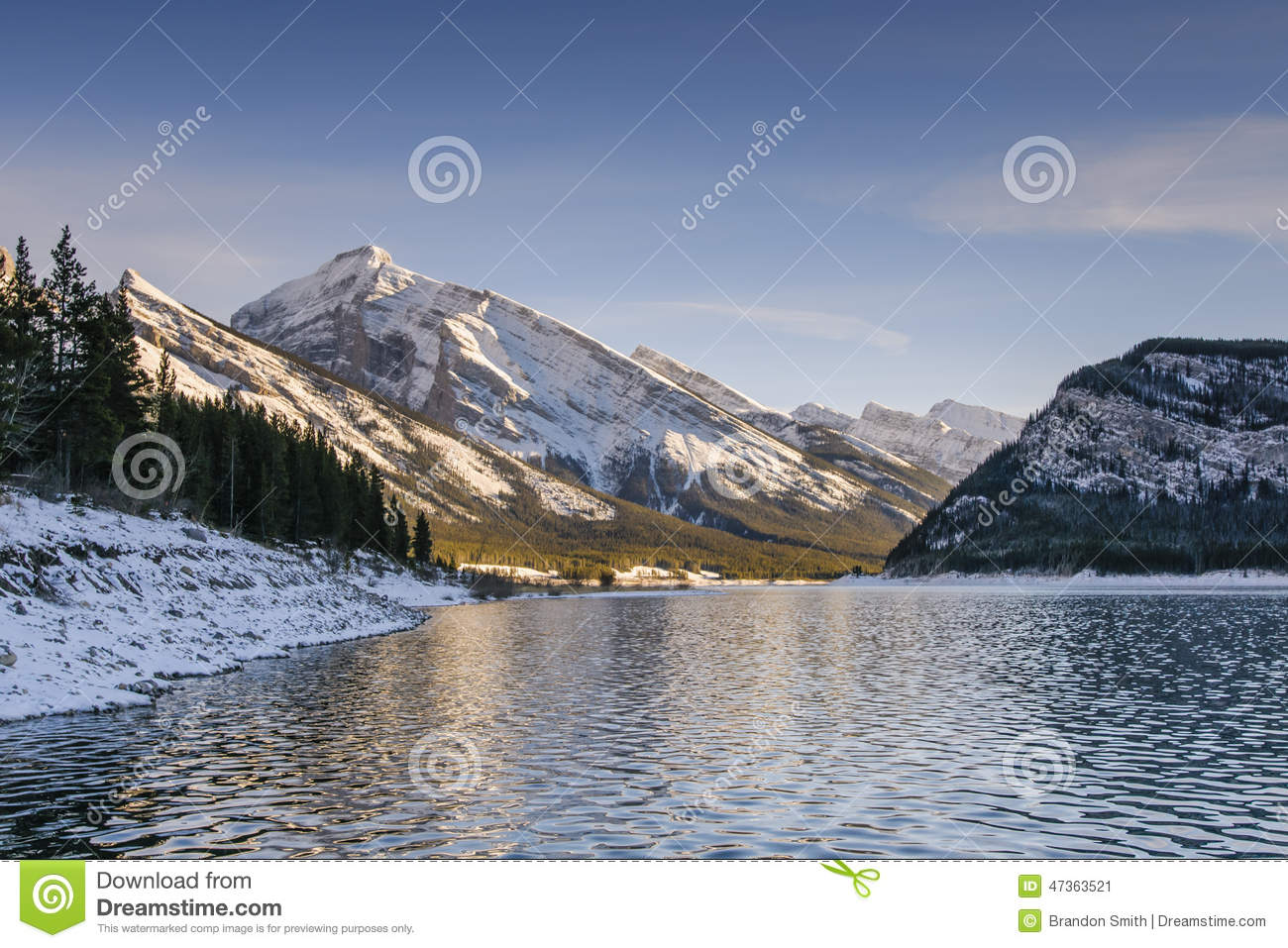 Sunset over a mountain lake in early winter, Kananaskis Country ...