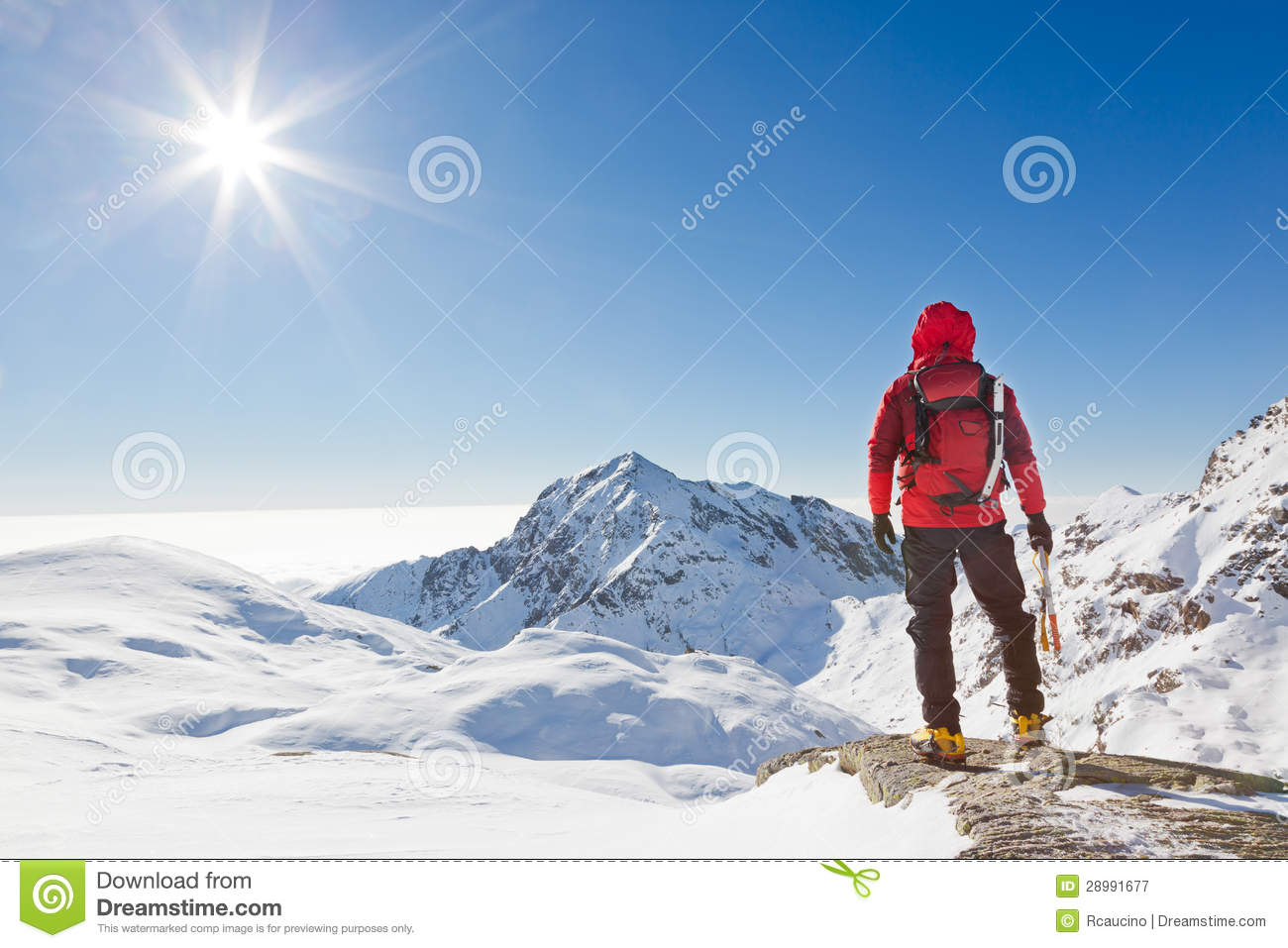 Mountaineer Looking At A Snowy Mountain Landscape Stock ...