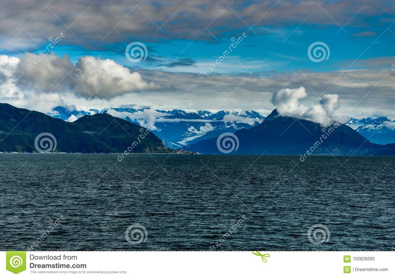 Mountains covered in clouds on a misty morning on the Ferry towa