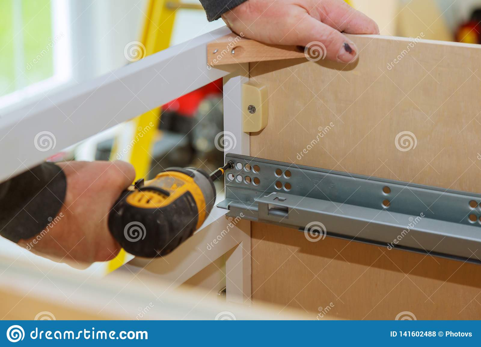 Mounting Furniture With Screwdriver Fixing Cabinet Drawers Hinge Adjustment On Kitchen Cabinets Stock Photo Image Of Hinge Carpenter 141602488