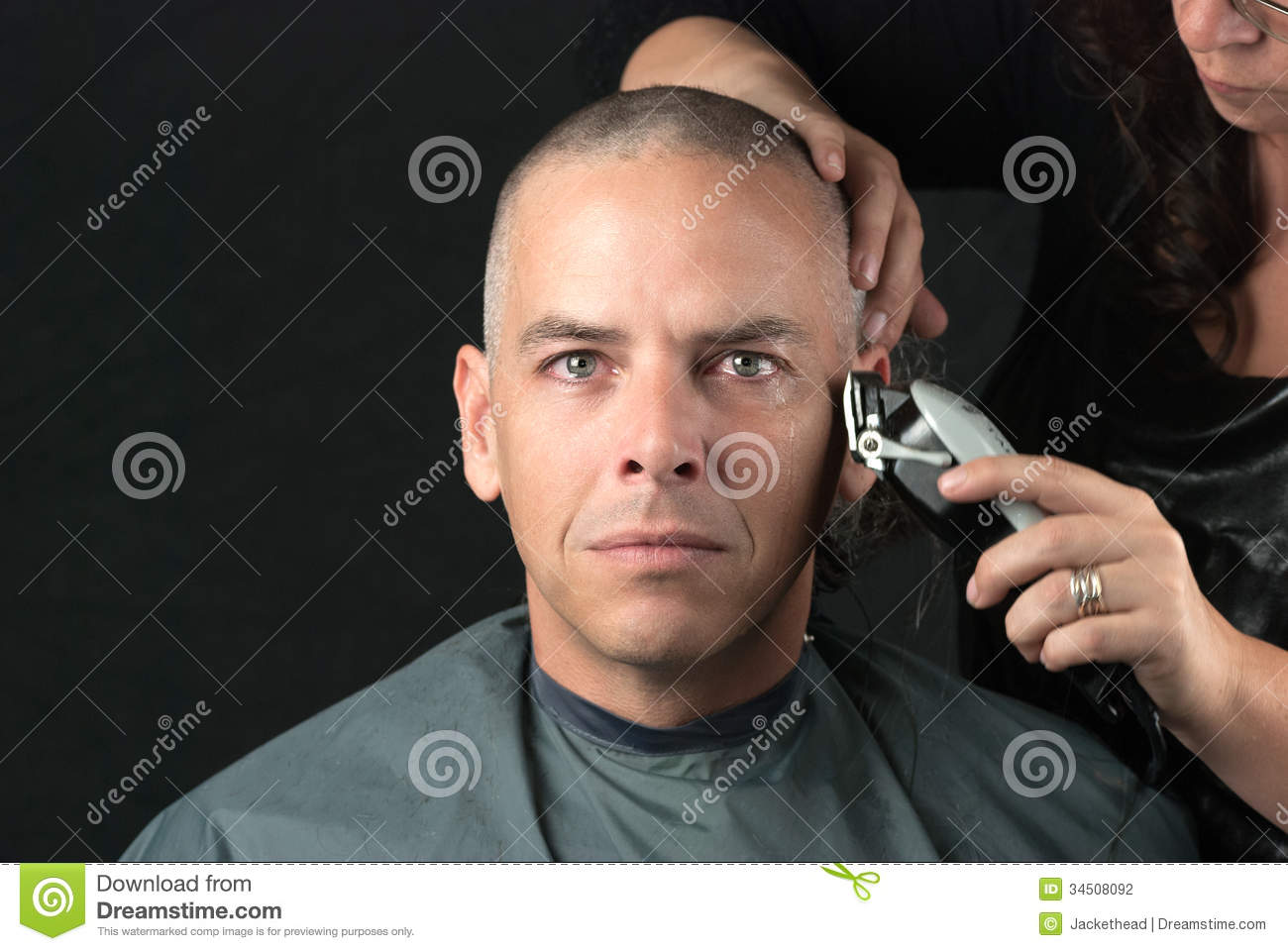 Picture of man getting his head shaved