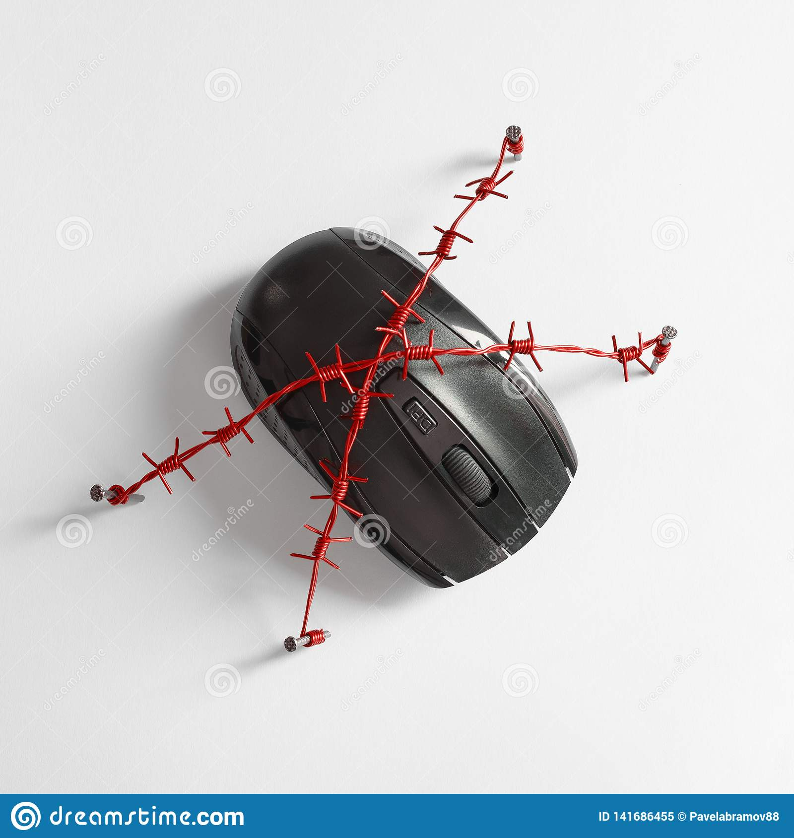 Mouse with red barbed wire. Concept for the theme of human dependence on social networks, the Internet and gaming addiction