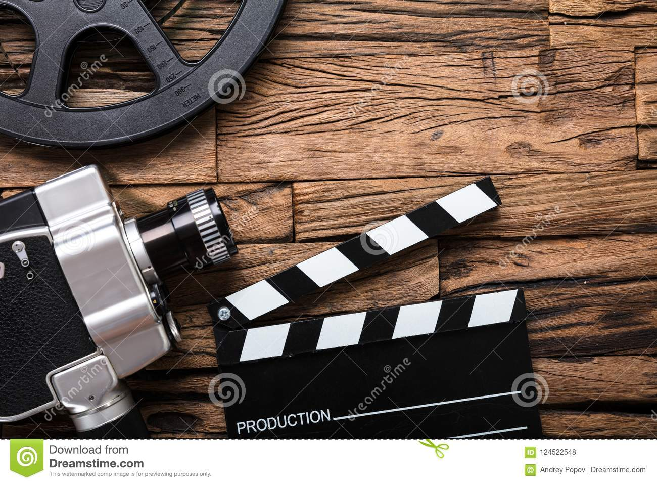 Movie Camera With Film Reel And Clapper Board On Wood Stock Photo - Image  of industry, concepts: 124522548