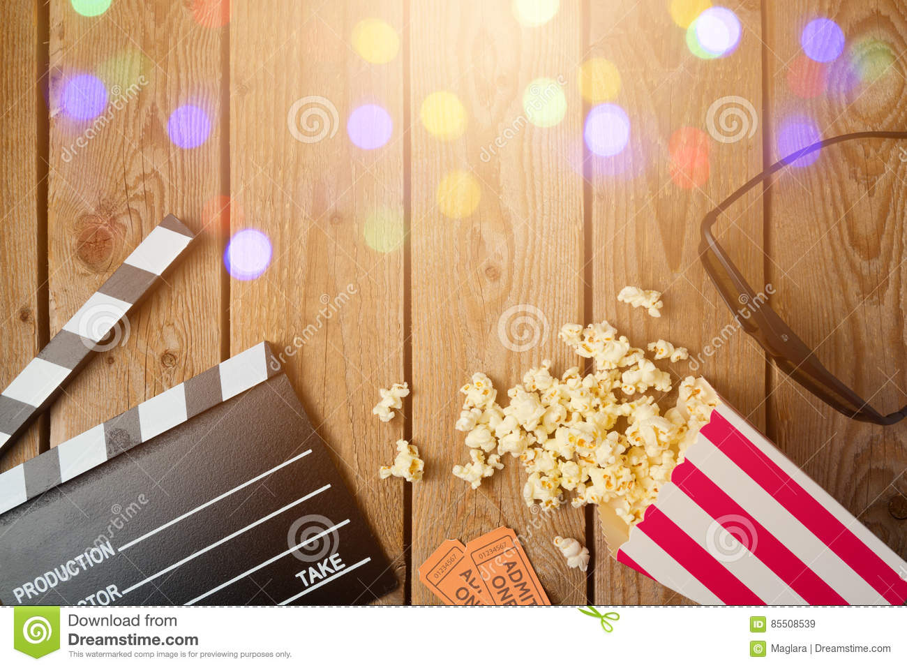 Movie clapper board, 3d glasses and popcorn on wooden background. Cinema concept.