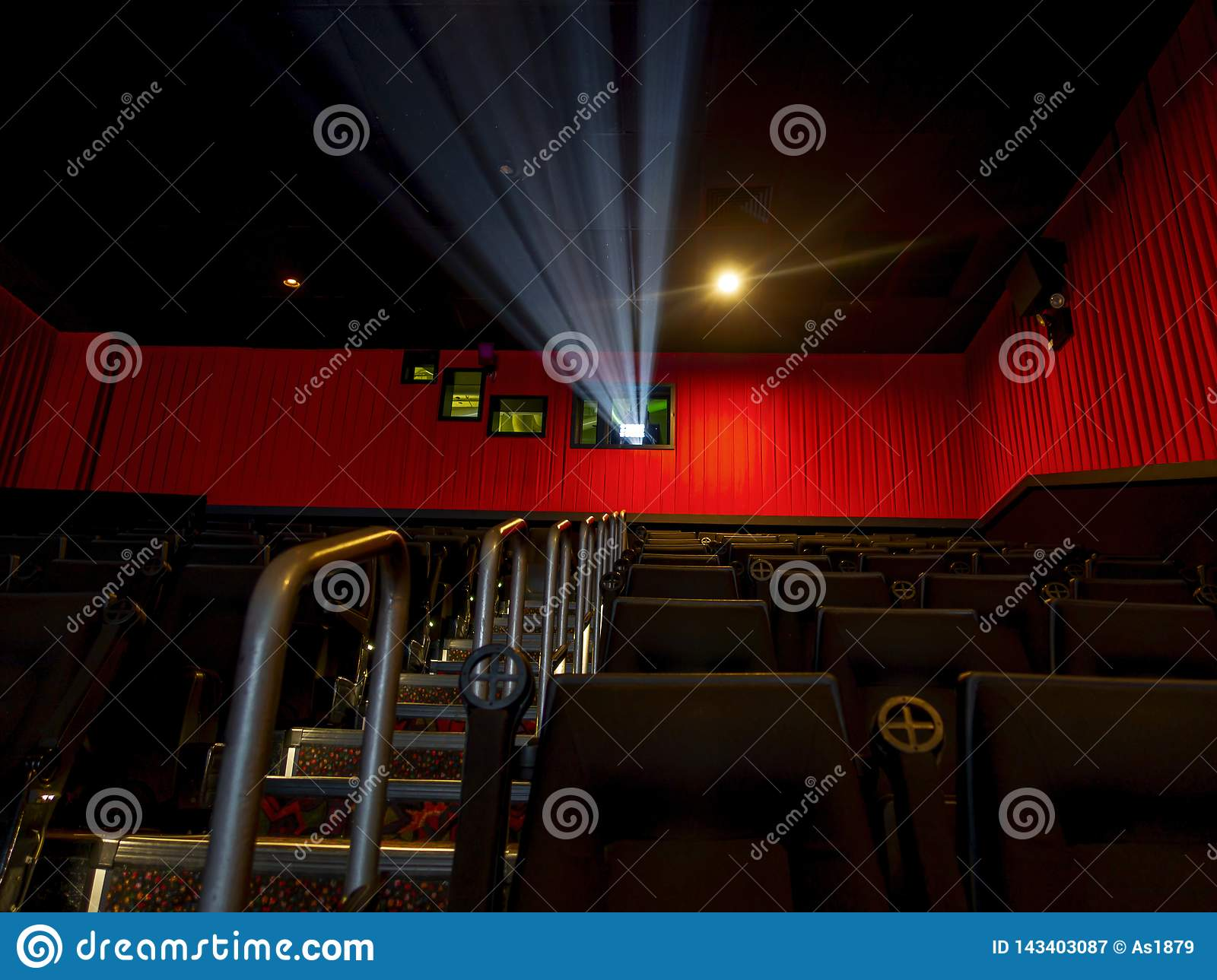 Movie Silver Screening Room Theater With Projector Light On And Seating And Stairs On Lush Red Color Curtains Stock Image Image Of Screening Play 143403087