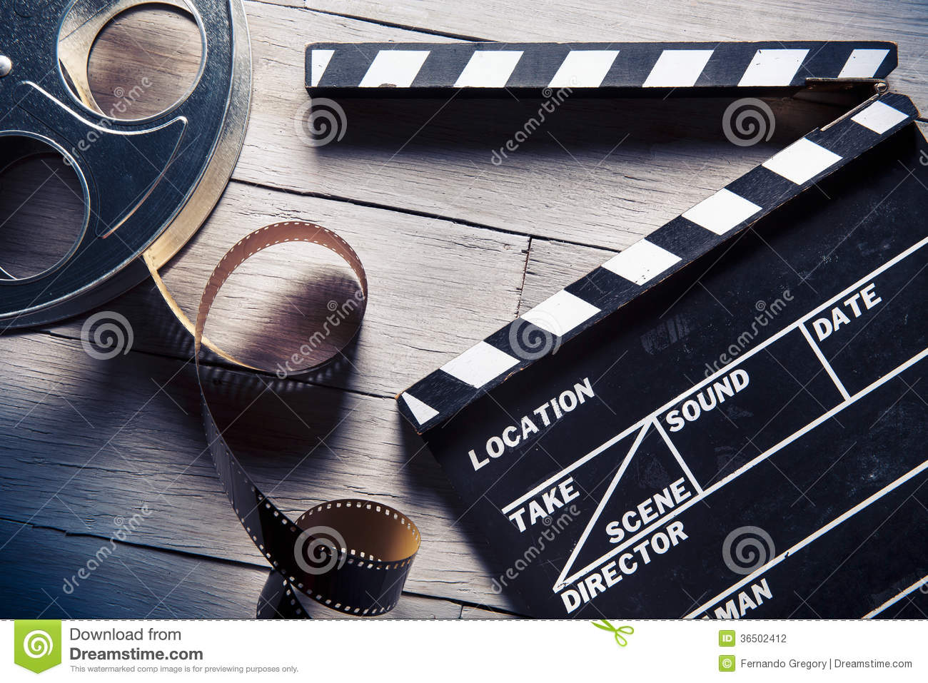 Movie Slate And Film Reel On Wood Stock Photography ...