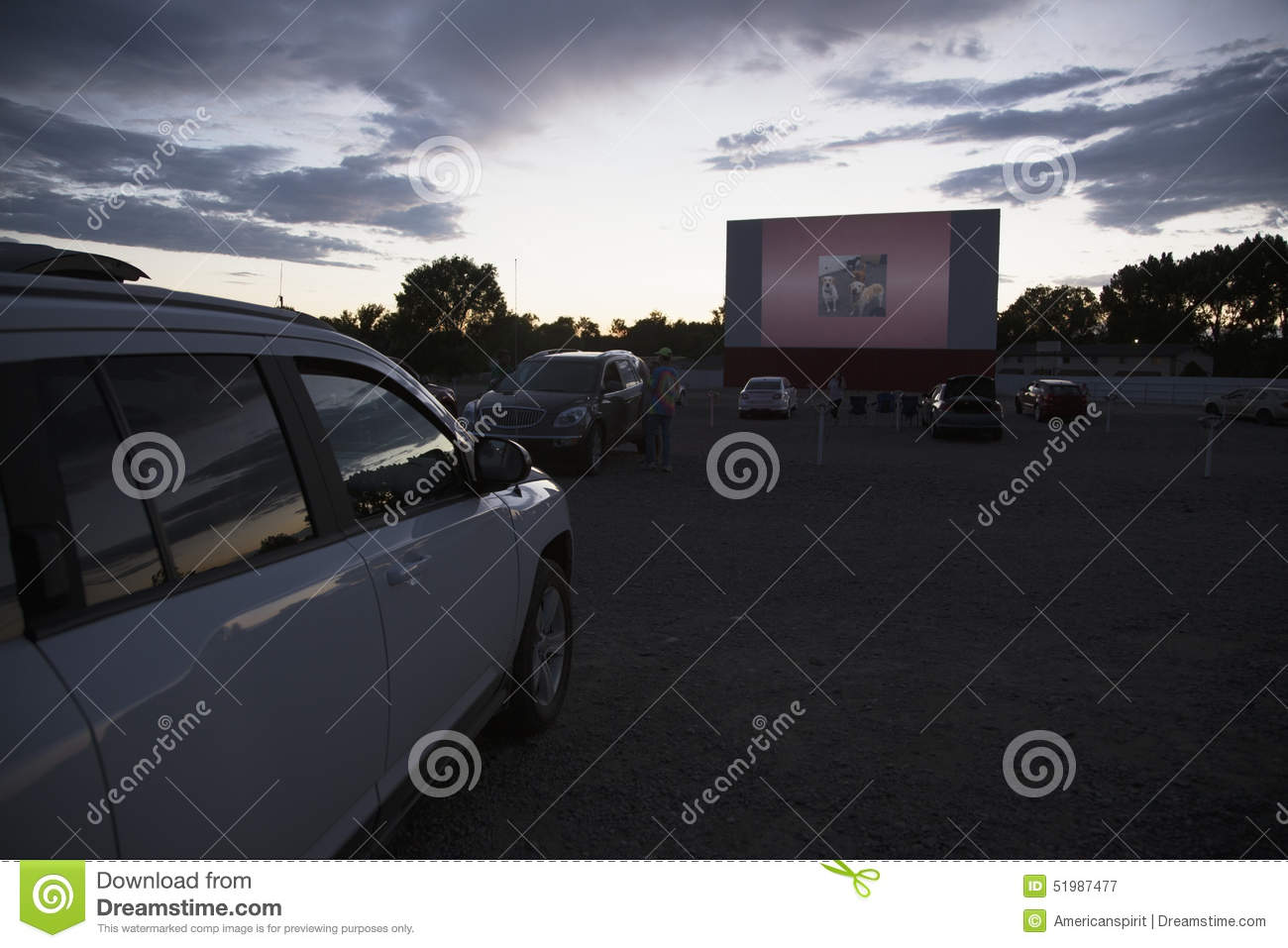 movie viewers in car at star drive in movie theater